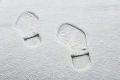 Abdruck im Schnee Stockfotos