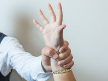 Abductor, forcefull man's hand on a female. Royalty Free Stock Image
