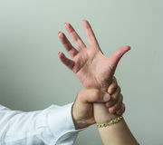 Abductor, forcefull man's hand on a female. Royalty Free Stock Photos