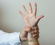 Abductor, forcefull man's hand on a female. Royalty Free Stock Images