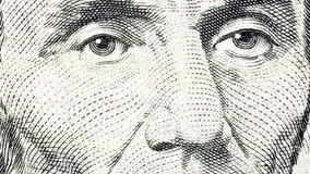 Abe Lincoln Macro Zoom. Macro zoom of Abraham Lincoln's face and eyes on the US five dollar bill stock video footage