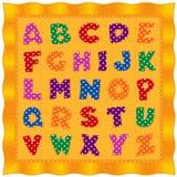 Abecadła dziecka kołderka, jaskrawi polki kropki listy, złocisty tło Obrazy Stock