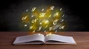 Abecadło listy nad książką zdjęcie stock