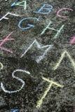 Abecadło pisać w kolorowej kredzie Obrazy Royalty Free