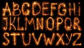 Abecadło robić sparklers odizolowywający na czerni zdjęcie stock