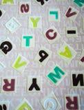 Abecadła na tkanina dywanu powierzchni Obrazy Royalty Free