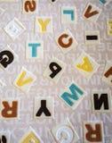 Abecadła na tkanina dywanu powierzchni Zdjęcia Stock