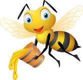 Abeille heureuse avec le seau de miel Photos stock