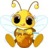 Abeille mignonne mangeant du miel Image libre de droits