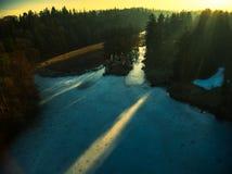 Abej?n congelado de la puesta del sol del lago Pruhonice fotos de archivo libres de regalías