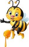 Abeja de la historieta que sostiene el cazo de la miel Imagen de archivo