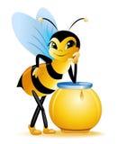 Abeja y miel Imagenes de archivo
