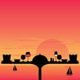 Abendessen-Sonnenuntergang auf dem Strand Stockbilder