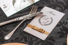 Abendessenplatz mit Menüweiß Stockfotografie