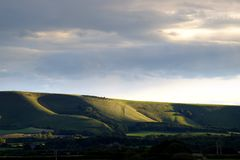Abendlicht auf dem Süd- Abstieg-Nationalpark, nahe Firle, Ost-Sussex Lizenzfreie Stockfotos