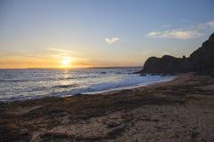 Abendsonnenuntergang an der Hoffnungs-Bucht, Devon, England Lizenzfreie Stockfotografie