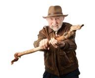 Abenteurer oder Archäologe, die sich verteidigen Stockbild