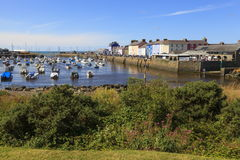 Aberaeron harbour. With plenty of boats moored and its colourful buildings in West Wales Royalty Free Stock Images