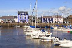 Aberaeron harbour. With plenty of boats moored and its colourful buildings in West Wales Stock Image