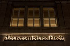Abercrombie & Fitch logo on their Munich main shop taken at night. Abercrombie & Fitch is American retailer specialized in Youth w. Picture of the Munich Royalty Free Stock Photos