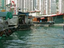 Aberdeen, Hong Kong: Tradition Versus Progress. The fishing village of Aberdeen in Hong Kong, where people live on boats Stock Photography