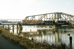 Aberdeen, Washington / USA - March 10, 2018: The Puget Sound & Pacific Railroad Wishkah River Bridge is an important part of Grays. Landscape image of a train royalty free stock photos