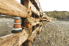 Aberiddy Beach, remains of sea defences, with artistically arran Stock Image