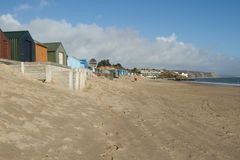 Abersoch beach. Abersoch beach, Gwynedd, North Wales, UK. Very popular tourist location with clean beach and water flanked by beach-huts Stock Photo