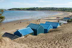 Abersoch beach. Abersoch beach, Gwynedd, Wales, UK, with beach huts overlooking the bay and people on the sand Royalty Free Stock Photography