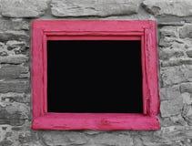 Abertura quadro madeira na parede de pedra Fotografia de Stock Royalty Free