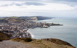 Aberystwyth Royal Pier and Town. Panorama of Aberystwyth taken from Constitution Hill, showing the Royal pier and harbour entrance with Cardigan Bay in the Stock Image