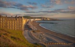 Aberystwyth sjösida på solnedgången Royaltyfri Bild