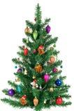 Abeto adornado de la Navidad aislado en blanco Imágenes de archivo libres de regalías