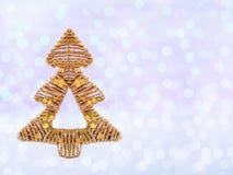 Abeto do Natal no fundo do feriado do brilho Imagens de Stock Royalty Free