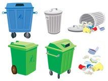 Abfall- und Abfalldosen und ein Korb Stockbild