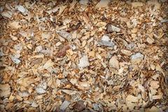 Abfall von Holzbearbeitung - Sägemehlhintergrund Lizenzfreie Stockfotografie