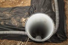 Abflussrohre und Inspektion gut für Abbau des Wassers von einem s Stockbild