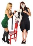 Abgedeckte Frau und eine Puppe Stockbild