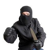 Abgedeckter Verbrecher, der ein Messer anhält Stockbilder