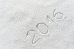 abgehobener Betrag 2016 auf Schnee Stockfoto