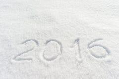 abgehobener Betrag 2016 auf Schnee Stockfotos
