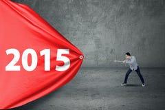 Abgehobener Betrag Nr. 2015 des jungen Mannes Lizenzfreie Stockfotos