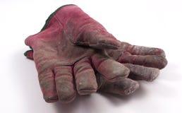Abgenutzte Handschuhe getrennt auf weißem Hintergrund. Stockbild