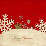 Abgenutzte Weihnachtskarte mit Schneeflocken Stockfoto