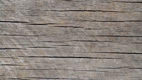 Abgenutzter und verwitterter horizontaler gekörnter hölzerner Hintergrund Stockfotografie