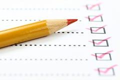 Abgeschlossene Checkliste stockbilder