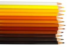 Farbige hölzerne Bleistifte machen Vignette Stockfoto