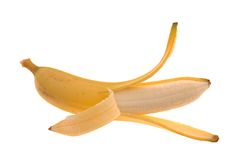 Abgezogene goldene Banane Lizenzfreie Stockfotos