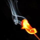 Abgleichung in der Flamme und im Rauche Stockbilder