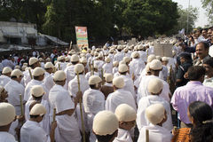1000 Gandhi dressed children walking on street Stock Image